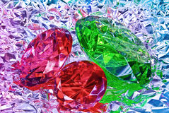 Precious stones,jewelry on the background of silver foil Royalty Free Stock Images