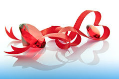The precious stones and red tape in the form of the heart Royalty Free Stock Photography