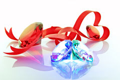 The precious stones and red tape in the form of the heart Royalty Free Stock Photos