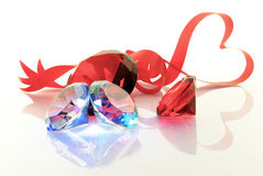 The precious stones and red tape in the form of the heart Stock Image