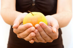 Precious Vitamins. Woman holding an Apple in her Hand Royalty Free Stock Image