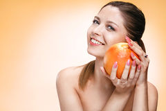 Precious woman with orange fruit Stock Photos