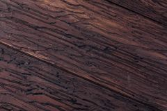 Precious wood texture. Of rustic aspect and dark, ocher, brown, toasted, black tones. The veins and knots are appreciated stock image
