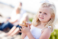 Precious Young Little Blonde Girl with Starfish Stock Photo