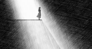 Precipice. Man standing close to the edge abstract Stock Image
