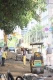 Precipitação-reparo a estrada Foto de Stock