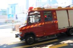 Precipitación del coche de bomberos, filtrando imagen fotos de archivo libres de regalías