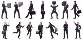 Precipitare dell'uomo d'affari isolato sui precedenti bianchi Fotografia Stock