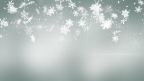 Precipitazioni nevose di Natale su fondo grigio Fotografia Stock Libera da Diritti