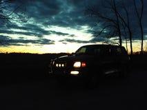Precis en vadställe och en solnedgång arkivfoto