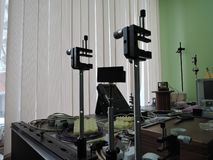 Precise angle optical mounts on optical table royalty free stock photos