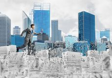 Precise businessman in suit running with phone. Attractove businessman in suit running with phone in hand among flying letters with cityscape on background Royalty Free Stock Photo