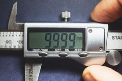 Precise. Details of modern measuring tool, digital display showing precise dimension in two decimals Stock Photography