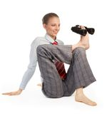Precise forecast. Business woman sitting in flexible pose and holding binoculars with her leg describing precise forecast concept Stock Photography