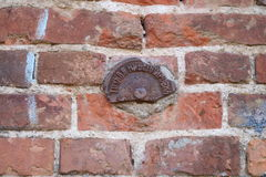 Precise leveling, very old plaque in Russian. Brick wall Royalty Free Stock Photos