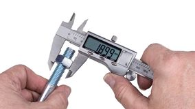 Precise measurement of bolt with nut by digital caliper royalty free stock photo