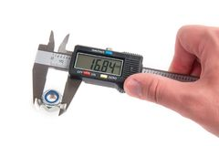 Measuring with electronic digital caliper stock image