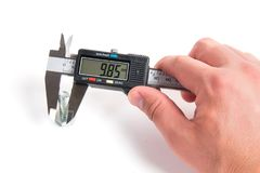 Precise measurement of metal part. Measuring with electronic digital caliper stock photos