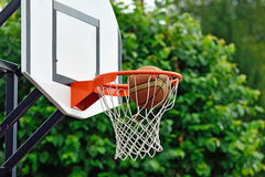 Precise shot. Basketball ball flies into the shopping cart Royalty Free Stock Photo