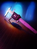 Precision. Measuring calipers on stainless steel sheet backlit with colored lights Stock Image