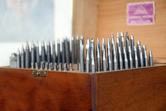 Precision tools. Photo of box of metal precision tools for printing or clockmakers Stock Image