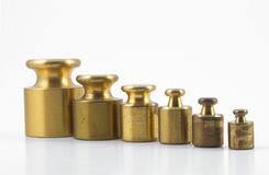 Precision Weights. A set of precision weights for a balance scale Stock Photos
