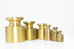 Precision Weights. A set of precision weights for a balance scale Royalty Free Stock Photography