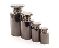 Precision weights set. Shiny precision weights set in a row - isolated stock photography