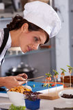 Precision work. Female chef putting the finishing touch to a small amuse Stock Photos