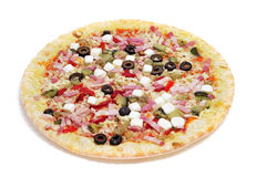 Precooked pizza with bacon, olives, cherry tomatoes, goat cheese. Red pepper and eggplant, on a white background Stock Photography
