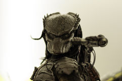 Predator Character Figurine. Large scale, extremely detailed and realistic Predator movie character figurine on a sophisticated toy and model store stock photo
