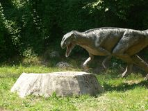 Predator dinosaur in the wood of the Extinction Park in Italy Stock Photo