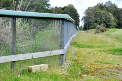 Predator trap at the Bois Gentil Kiwi Crèche, New Zeland. Greymouth, South Island, New Zealand, November 22, 2016: Predator trap beside a fence at the Bois stock images