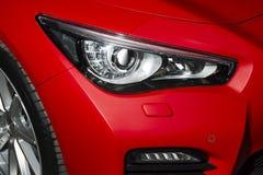 Predatory car headlight Stock Images