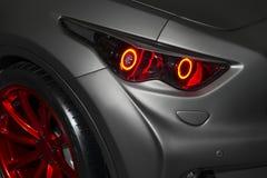 Predatory car headlight Stock Photo