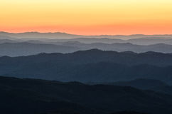 Predawn light, Blue Ridge Mountains, North Carolina. Predawn glow over the Blue Ridge Mountains as seen from Table Rock Mountain in North Carolina near the Stock Photography