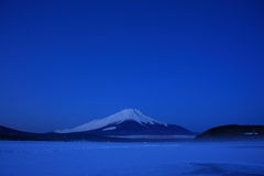Predawn Mt. Fuji over freeze up Lake Yamanaka Stock Images