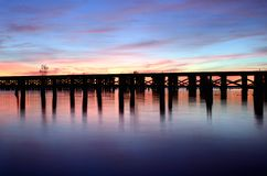 Predawn railroad bridge over a river. A railroad bridge crossing a river before sunrise Royalty Free Stock Photography