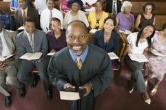 Predicador y congregación Foto de archivo libre de regalías