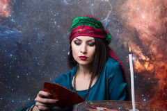 Predicting the future, access to the astral. Young beautiful fortune teller wondering on the Tarot cards. Predicting the future, access to the astral Stock Photo