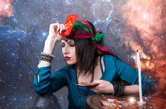 Predicting the future, access to the astral. Young beautiful fortune teller wondering on the Tarot cards. Predicting the future, access to the astral Royalty Free Stock Photo
