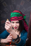 Predicting the future, access to the astral. Young beautiful fortune teller wondering on the Tarot cards. Predicting the future, access to the astral Royalty Free Stock Images
