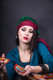 Predicting the future, access to the astral. Young beautiful fortune teller wondering on the Tarot cards. Predicting the future, access to the astral Royalty Free Stock Image