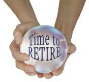 Predicting it is time for you to retire. Female hands holding a large crystal ball containing the words TIME TO RETIRE isolated against a  white background Stock Images