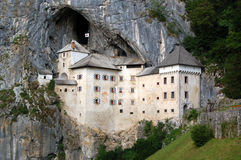 Predjama Castle. (also known as Predjamski Grad) is a Renaissance castle built within a cave mouth in southwestern Slovenia. It is approximately 11 kilometres Stock Image