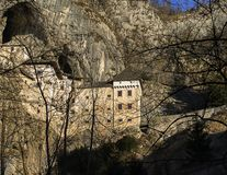 Predjama castle build into rock wall. Located in Postojna, Slovenia royalty free stock images