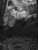 Predjama castle build into rock wall. Located in Postojna, Slovenia royalty free stock photography
