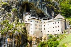 Predjama castle inside the mountain Stock Image