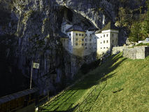 Predjama castle. One Of The Most Chilling Haunted Castles In The World. A castle built within a cave, now that is brilliant in terms of defense and offense. In Royalty Free Stock Image