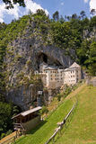 Predjama castle in the rock Stock Images